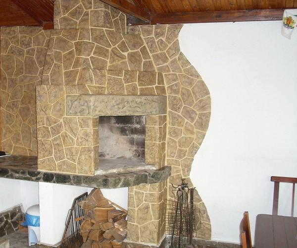 Облицовка из натурального камня придаст печи благородный вид.