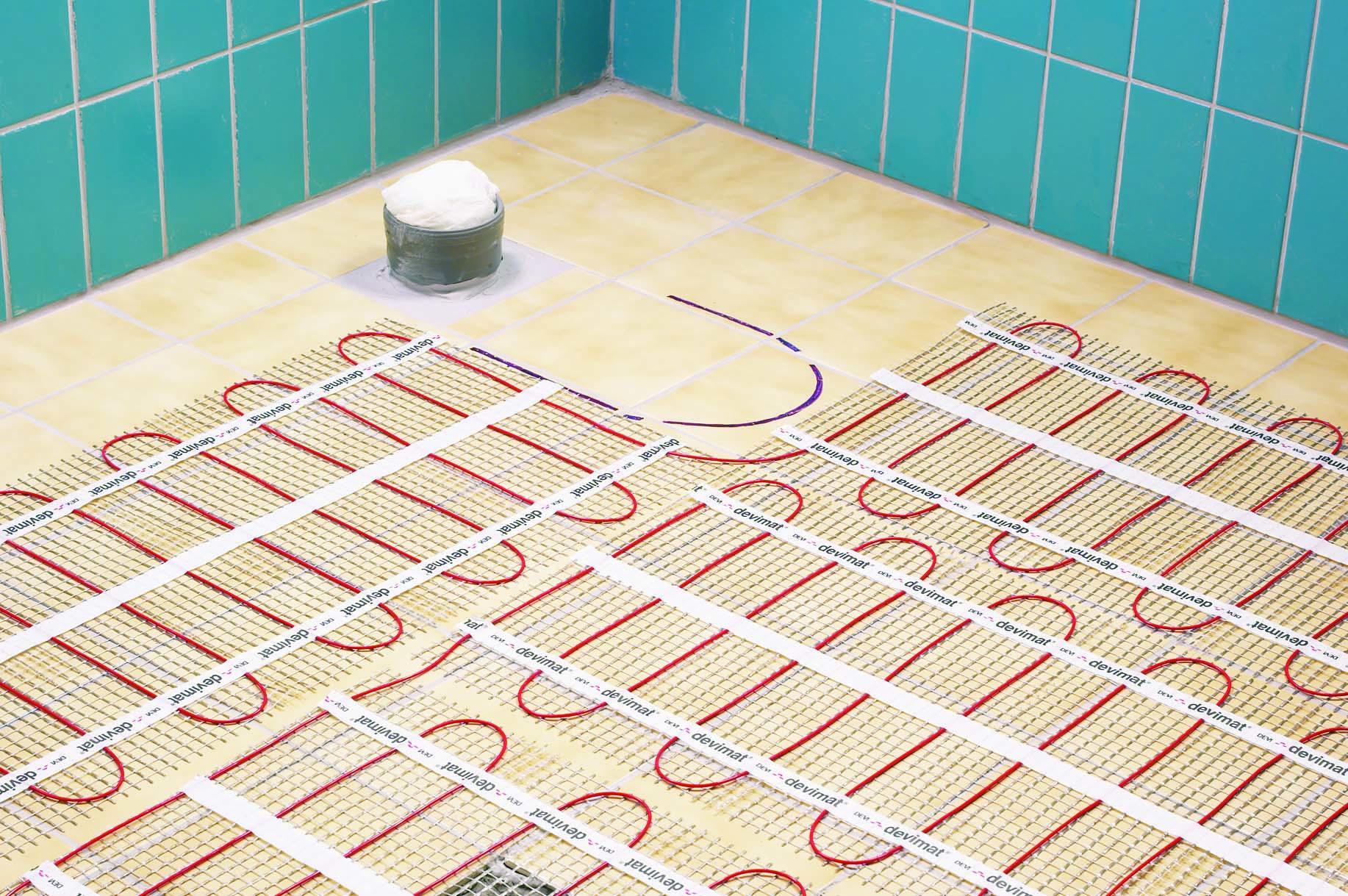 Как сделать электрический теплый пол в ванной и туалете